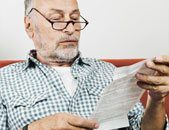 Photo of man reading patient leaflet for Viagra tablets
